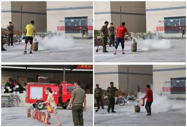 志成红木人认真进行消防安全培训 志成红木人现场操作消防安全工具